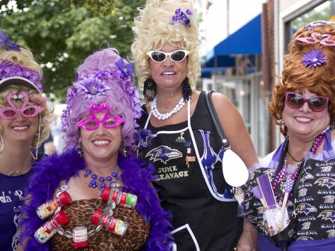 "Annual celebration honors traditional Baltimore ""Hon"" women with their distinct beehive hairdos and colorful attire"