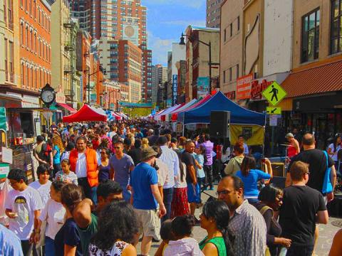 Strolling the booths at the All About Downtown Street Fair