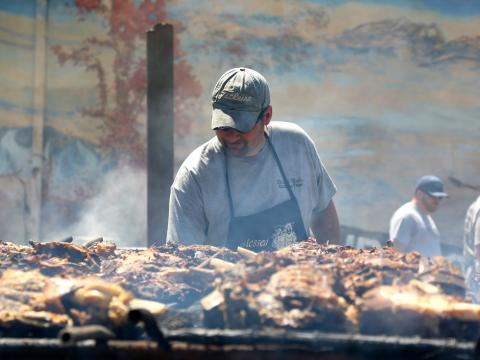 Cooking up some barbecued meats at the International BBQ Festival in Owensboro, Kentucky